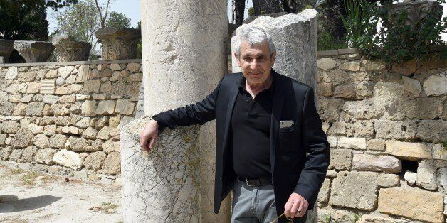 French actor Michel Boujenah poses for a photo at the archaeological site of Carthage, north of Tunis,...