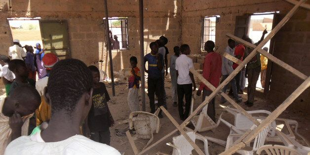 People gather inside the Redeemed Christian Church of God, after a bomb blast in Potiskum, Nigeria, Sunday,...