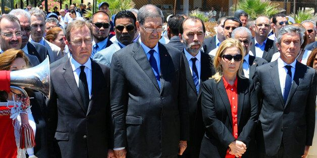 Tunisian Prime Minister Habib Essid, 2nd left, observes a one minute's silence near the Imperial Marhaba...