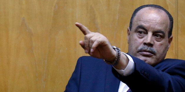 Tunisian Interior Minister Mohamed Najem Gharsalli gestures during a press conference in Imperial Marhaba...