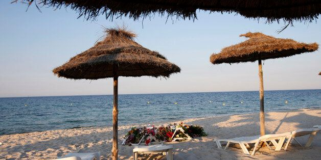 Lounge chairs and numerous flowers laid out at the scene of the attack in Sousse, Tunisia, Sunday, June...