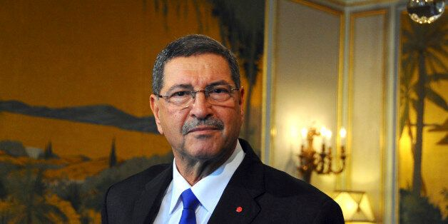 New Tunisian Prime Minister Habib Essid looks on after presenting his second government to the medias,...