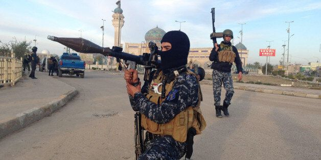 FILE - In this Saturday, Feb. 1, 2014, file photo, Iraqi security forces patrol in Ramadi, Iraq. More...