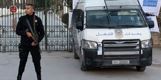 A Tunisian policeman stands guard in front of Tunisia's Bardo National Museum on March 23, 2015 in Tunis,...