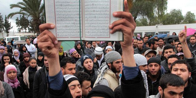 In this Wednesday March 7, 2012 photo an ultraconservative Muslim demonstrates with a Quran at the Manouba...