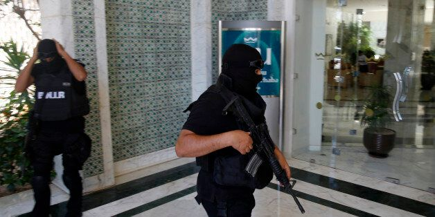 Tunisian police officers guard the Imperial Marhaba hotel during visit of top security officials of Britain,...
