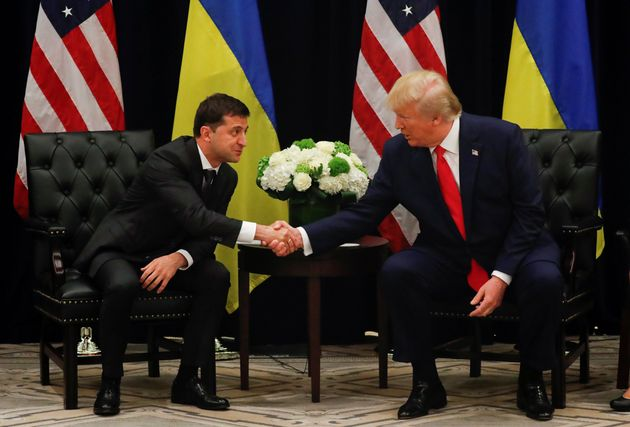 U.S. President Donald Trump shakes hands with Ukraine's President Volodymyr Zelensky during a bilateral...