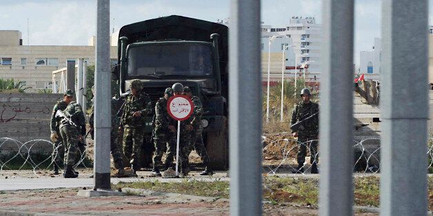 Soldiers control a district of Tunis, Thursday Jan. 13, 2011. Sporadic sounds of clashes and rounds of...