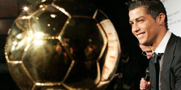 Portuguese international soccer star Cristiano Ronaldo watches his 'Ballon d'Or' (Golden Ball) award,...