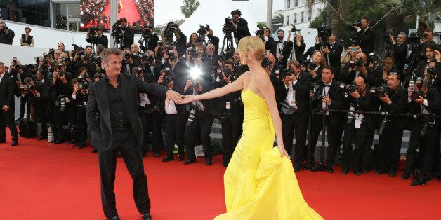 Sean Penn and Charlize Theron arrives for the screening of the film Mad Max: Fury Road at the 68th international...