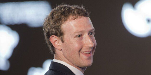 Facebook CEO Mark Zuckerberg asks a question during the CEO Summit of the Americas panel discussion in...