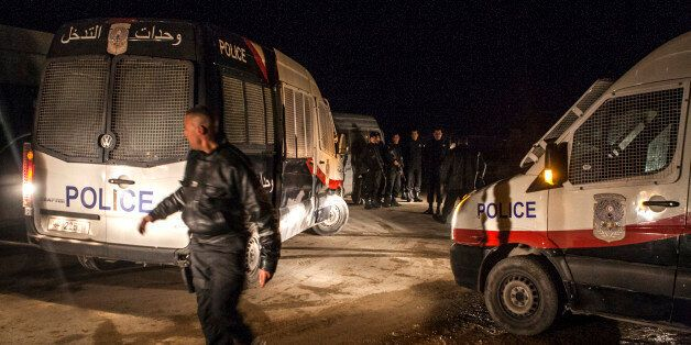 Police forces patrol near a house where suspected Islamist militants were hidden in Raoued, near Tunis,...