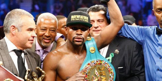LAS VEGAS, NV - MAY 02: Floyd Mayweather Jr. celebrates the unanimous decision victory during the welterweight...