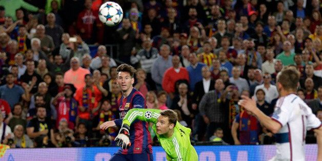 Barcelona's Lionel Messi, left scores his second goal past Bayern's goalkeeper Manuel Neuer during the...