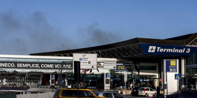 Smoke billows from Rome's Fiumicino airport main international terminal after a fire broke out overnight,...