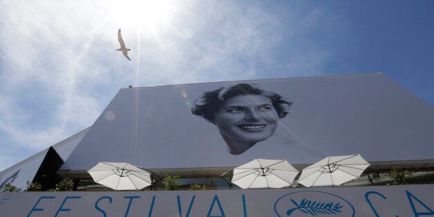 A bird flies past the official banner depicting actress Ingrid Bergman outside the Palais des Festivals...