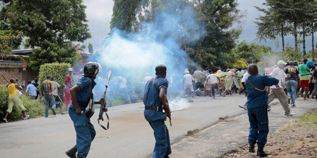 Demonstrators trying to march to the town center flee as police disperse them with tear gas, in the Ngagara...