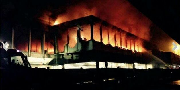 Flames rise from Rome's Fiumicino airport main international terminal after a fire broke out overnight,...