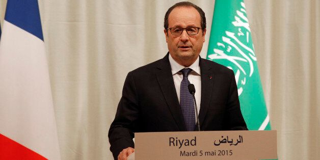 French President Francois Hollande delivers a speech during a press conference in Riyadh, Saudi Arabia,...