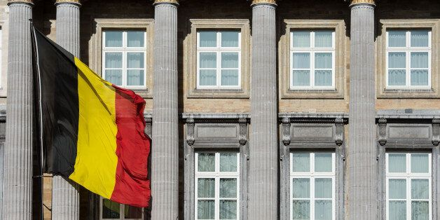 The Belgian flag flies outside the Belgian federal parliament in Brussels, Wednesday Feb. 12, 2014. Belgium,...