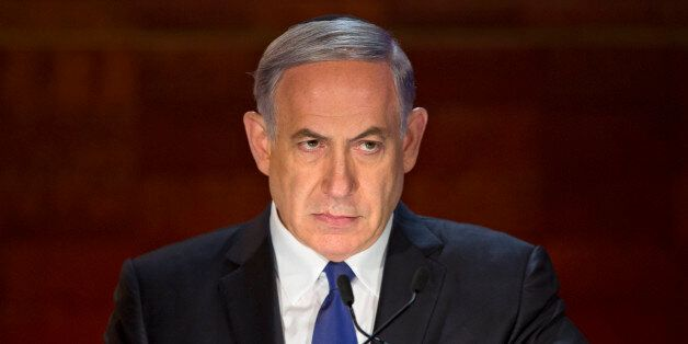 Israeli Prime Minister Benjamin Netanyahu looks on as he speaks at the opening ceremony of the Holocaust...