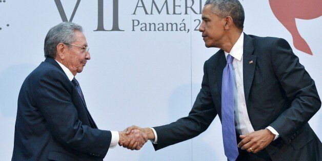 US President Barack Obama (R) shakes hands with Cuba's President Raul Castro (L) on the sidelines of...