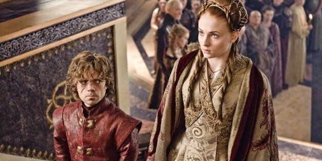 This publicity image released by HBO shows Peter Dinklage, left, and Sophie Turner in a scene
