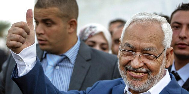 Rachid Ghannouchi, leader of the Tunisian moderate Islamist Ennahda Party, gestures before casting his...