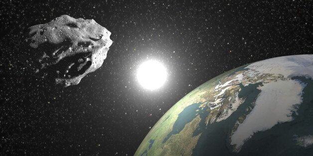 One asteroid into universe near earth planet, sun in the background - Elements of this image furnished...