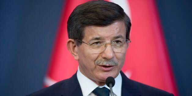 Turkish Prime Minister Ahmet Davutoglu speaks during a joint press conference with his Hungarian counterpart...