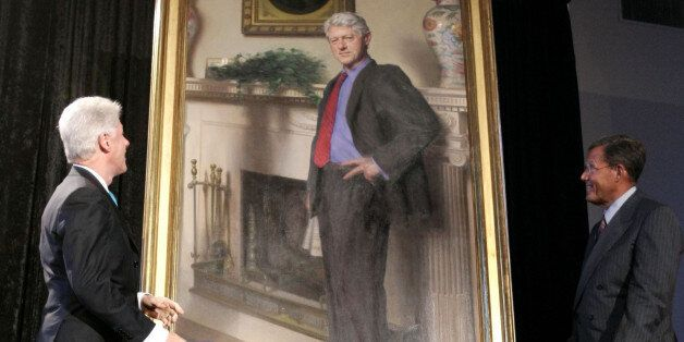 ile-This April, 24, 2006, file photo shows former President Bill Clinton, left, looking up at his portrait...