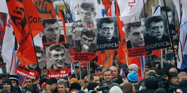 People march in memory of opposition leader Boris Nemtsov, who was gunned down on Friday, Feb. 27, 2015,...