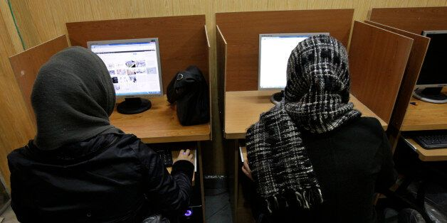 FILE- In this Monday, Feb. 13, 2012 file photo, Iranian women use computers at an Internet cafe in central...
