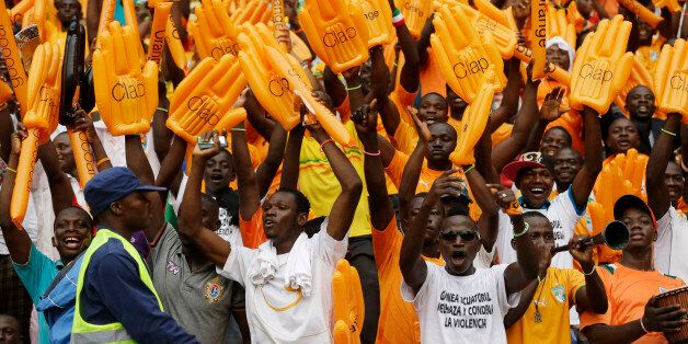 Ivory Coast soccer fans sing before their African Cup of Nations final soccer match with Ghana in Bata,...