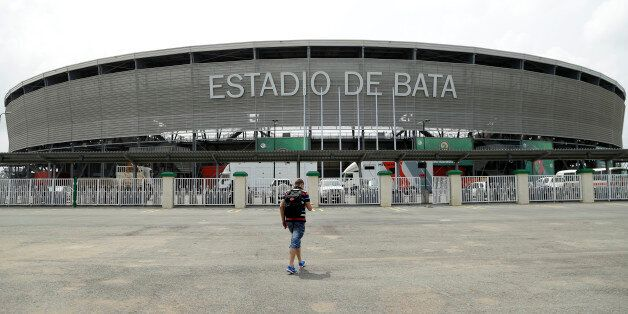A man walks in front of the Bata stadium in Bata, Equatorial Guinea, Friday Jan. 16, 2015 which will...