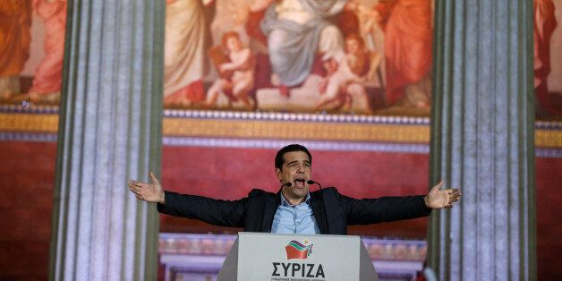 Leader of Syriza left-wing party Alexis Tsipras speaks to his supporters outside Athens University Headquarters,...