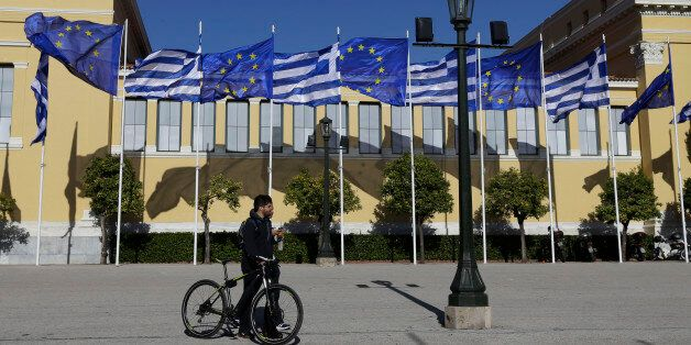 Greek and European Union's flags wave outside Zappeio Hall in Athens, on Friday, Jan. 23, 2015. All opinion...