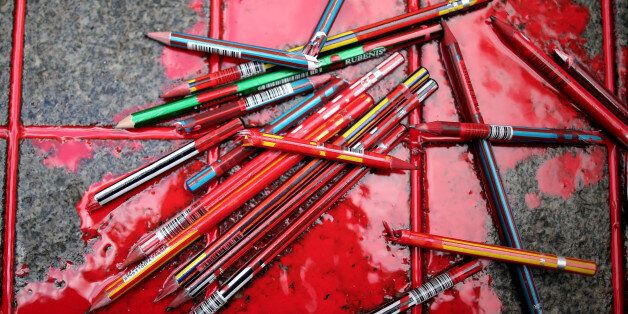 Broken pens lay on the ground as members of a leftist party gather outside the French consulate to pay...