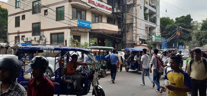 E_rickshaws driving haphazardly in Patel Nagar, New Delhi