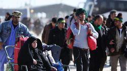 Des pèlerins iraniens affluent en Irak, un défi aux