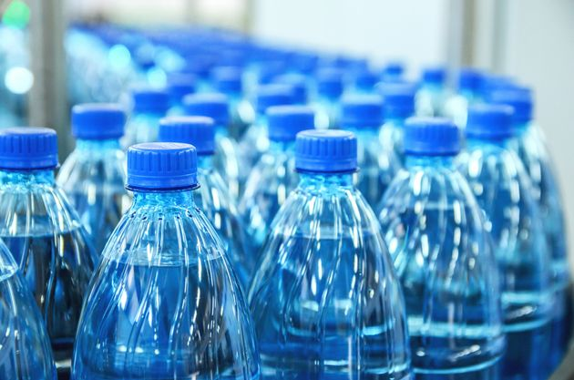 Closeup on mineral water green bottles in raw and
