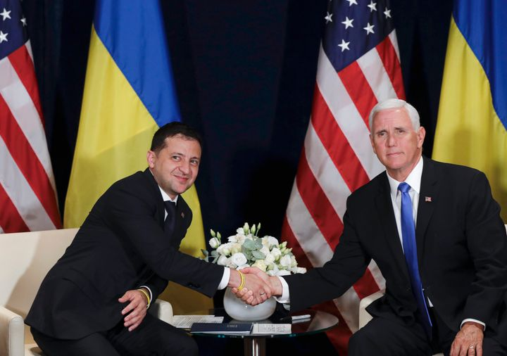 Ukrainian President Volodymyr Zelenskiy, left, shakes hands with U.S. Vice President Mike Pence in Warsaw, Poland, Sept. 1, 2