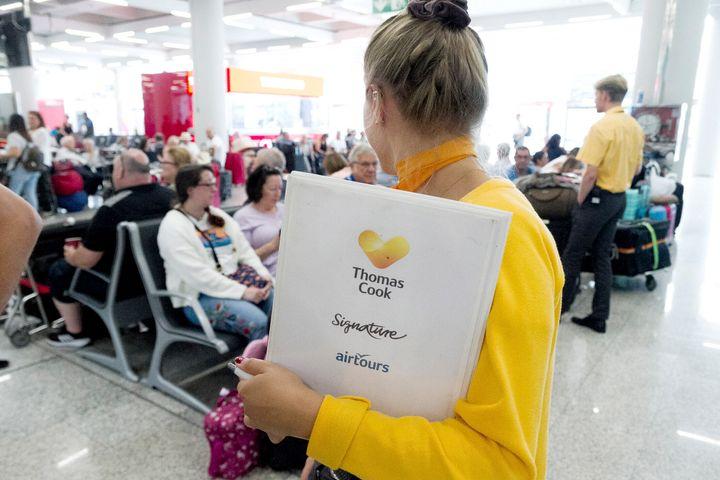 Thomas Cook staff giving information to British passengers at Palma de Mallorca airport on Monday.