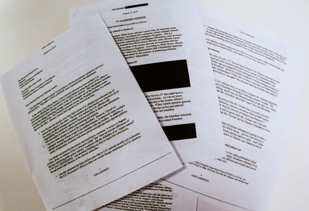 Photo illustration on September 26, 2019 shows redacted pages of the whistleblower complaint referring...