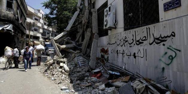 Les rues dévastées de Homs le 12 mai
