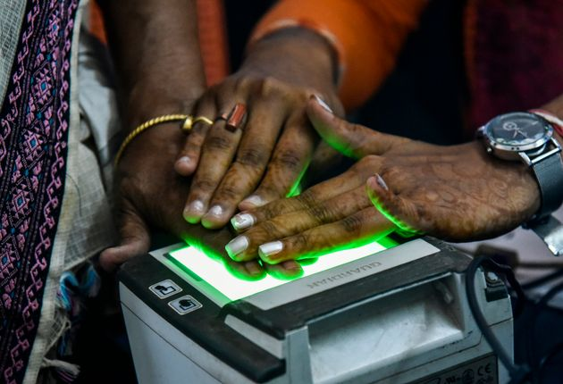 Women scanning fingerprints as an Adhar registration process in an Adhar registration office in Guwahati,...