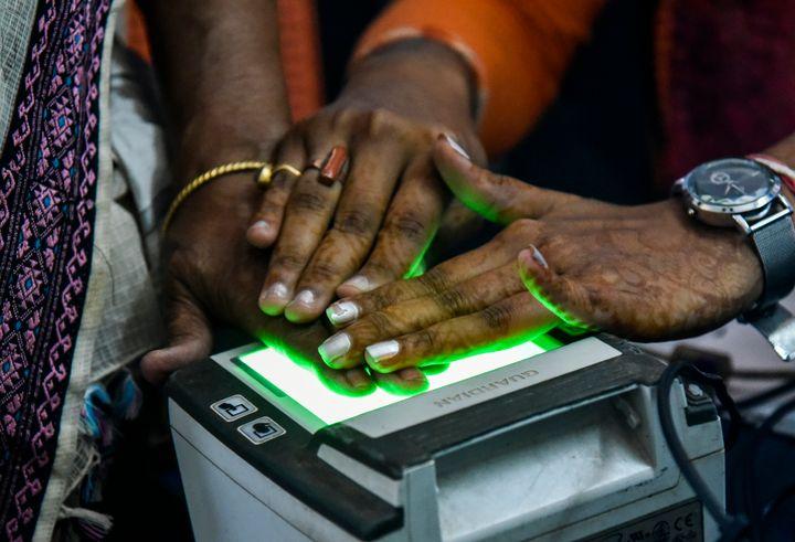 Women scanning fingerprints as an Adhar registration process in an Adhar registration office in Guwahati, Assam, India on Monday, October 8, 2018.