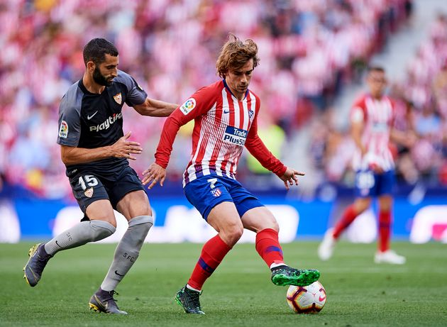 MADRID, SPAIN - MAY 12: Antoine Griezmann of Club Atletico de Madrid competes for the ball with Maxime...