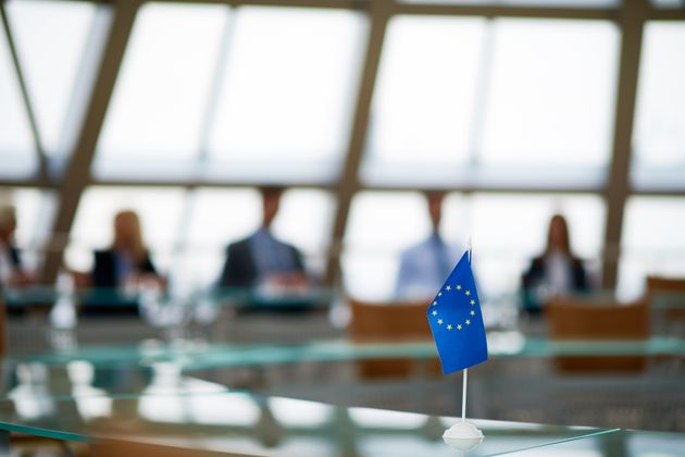 Meeting of European Union in conference room with glassy round