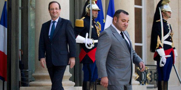 François Hollande sourit lors de la visite de Mohamed VI à